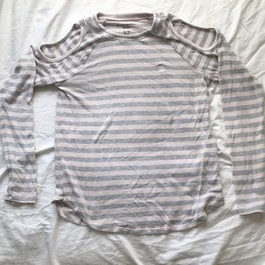 Long sleeve stripped shirt with cut out shoulder.